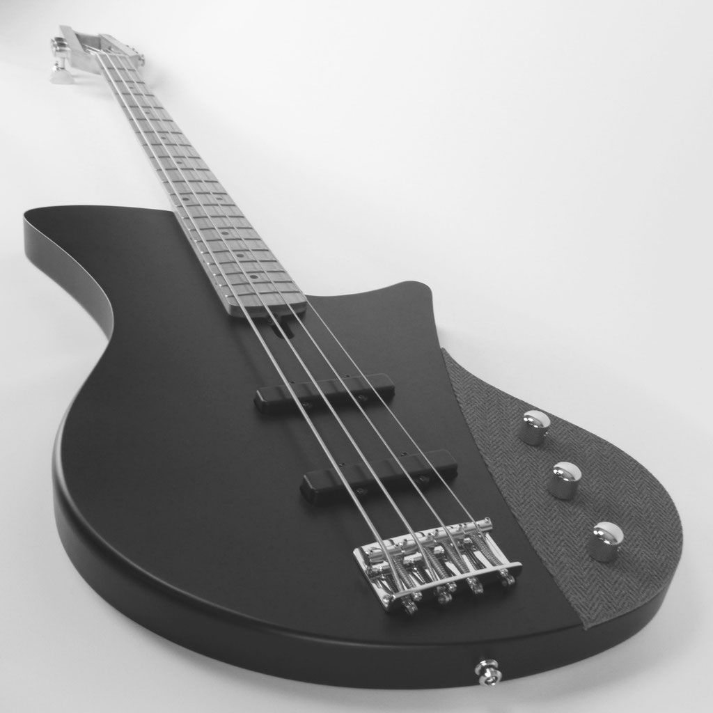 retro bassguitars with J-style pickups by harry haeussel with tweed cover