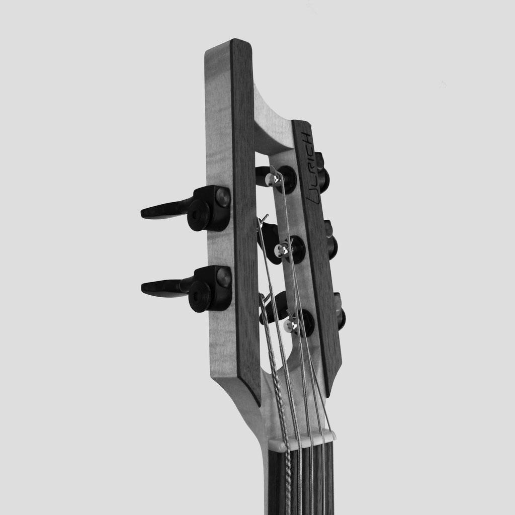 ulrich bass a modern slotted headstock design on a custom handcrafted bassguitar