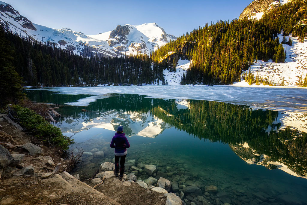 Standing on the shoreline of Middle Joffre Lake in Joffre Lakes Provincial Park