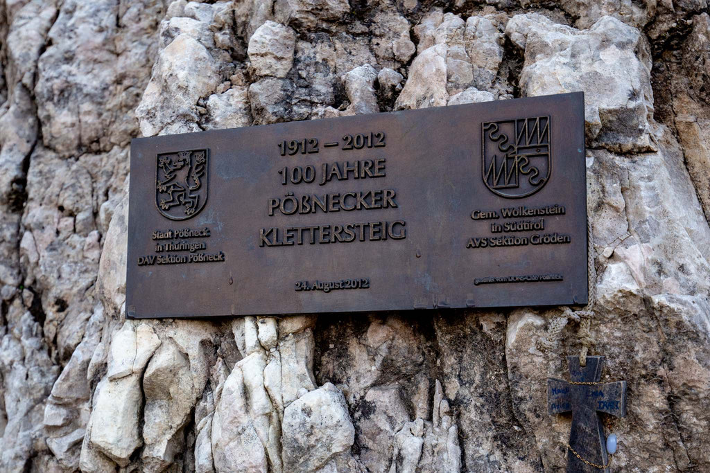 The signs at the start of the ferrata marking 100 years of the route's establishment