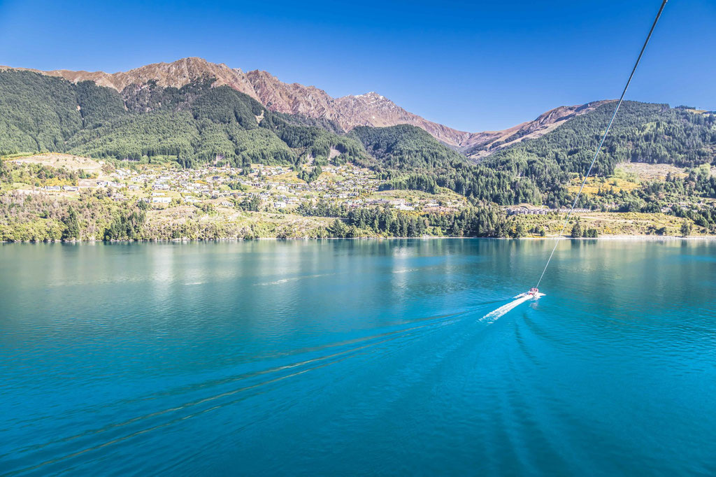 Parasailing in Queenstown, New Zealand. View onto Fernhil
