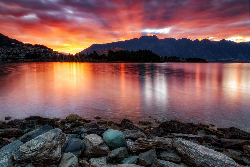 Sunrise on the shore of Lake Wakatipu with the Remarkables in the background