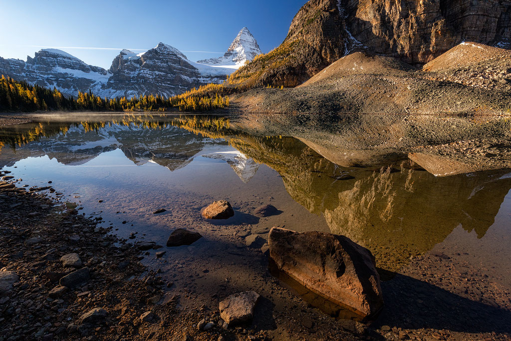 Mount Assiniboine reflecting in the Sunburst lake.