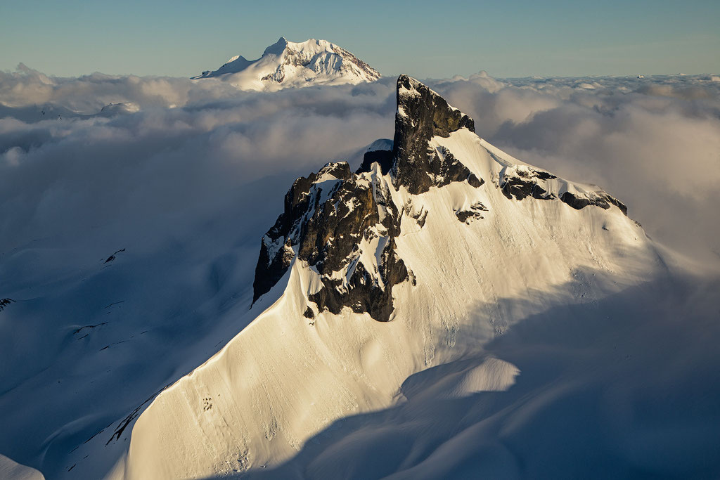 The Black Tusk and Mount Garibaldi photographed during a scenic flight over Garibaldi Provincial Park. Guide to Sea to Sky Highway