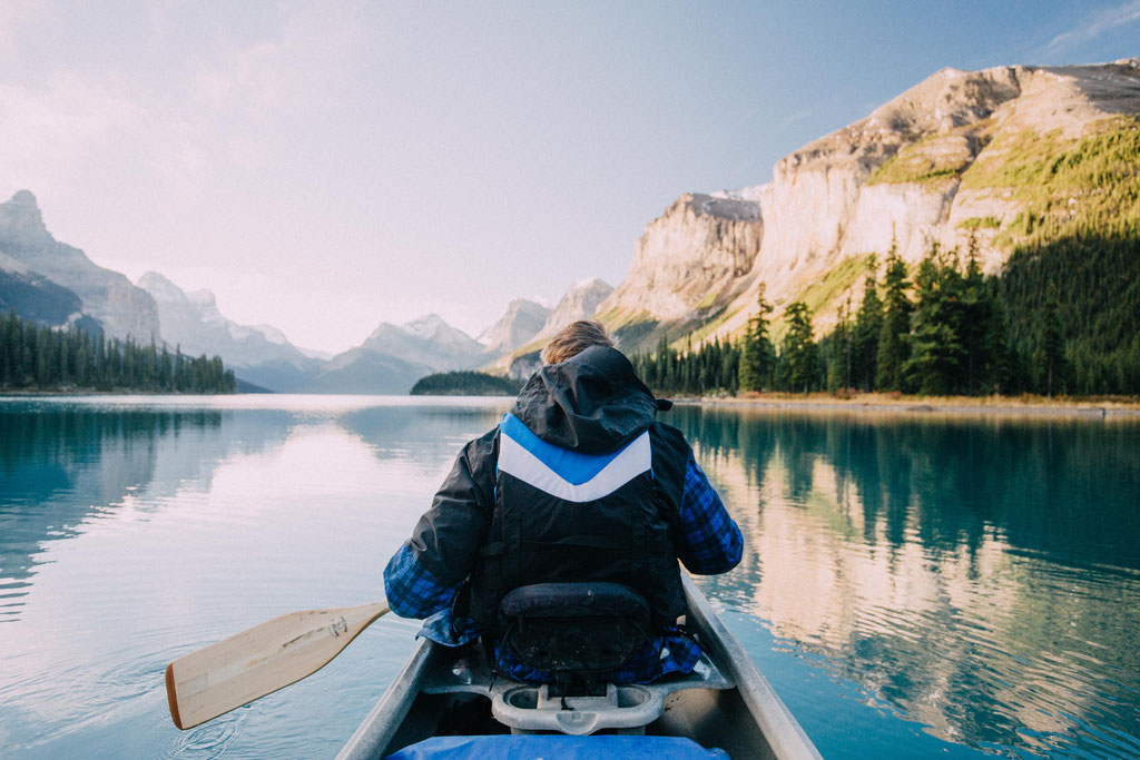 Canoeing on the Maligne Lake. Two week road trip itinerary around the Canadian Rockies