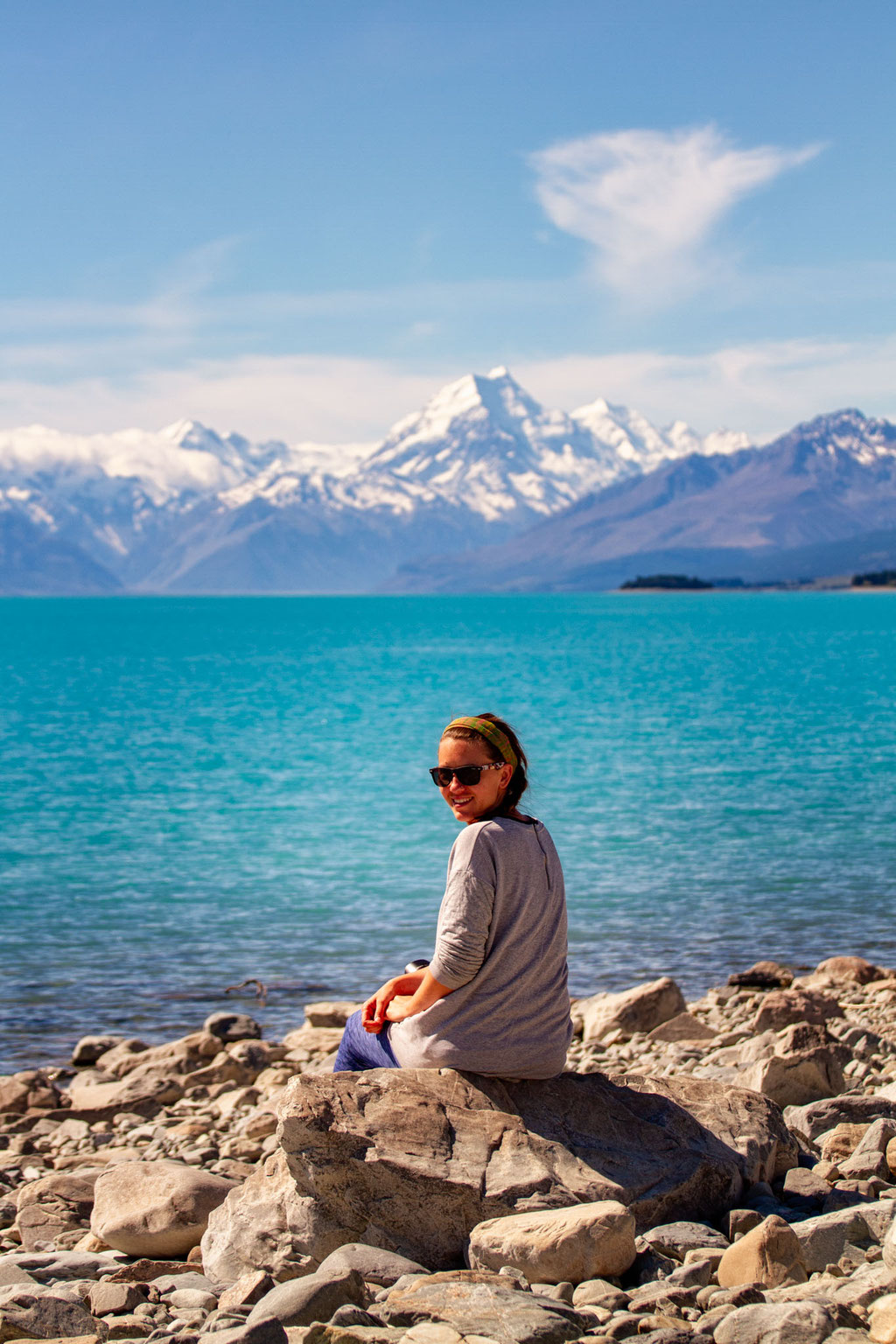 Me enjoying the sunshine at Lake Pukaki with Mount Cook in the background