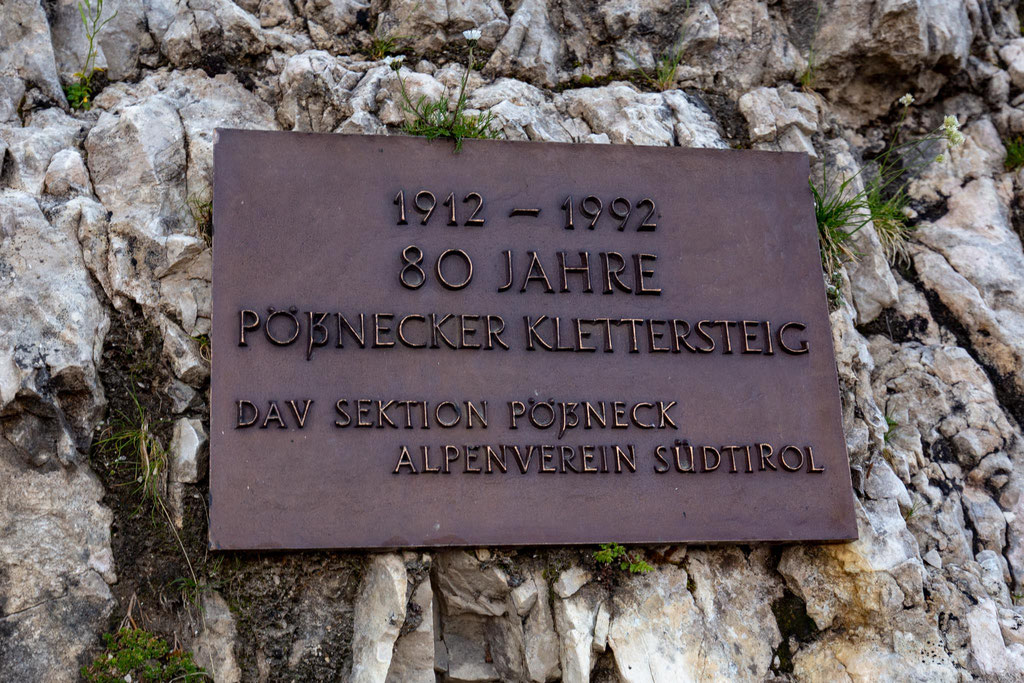 The signs at the start of the ferrata marking 80 years of the route's establishment