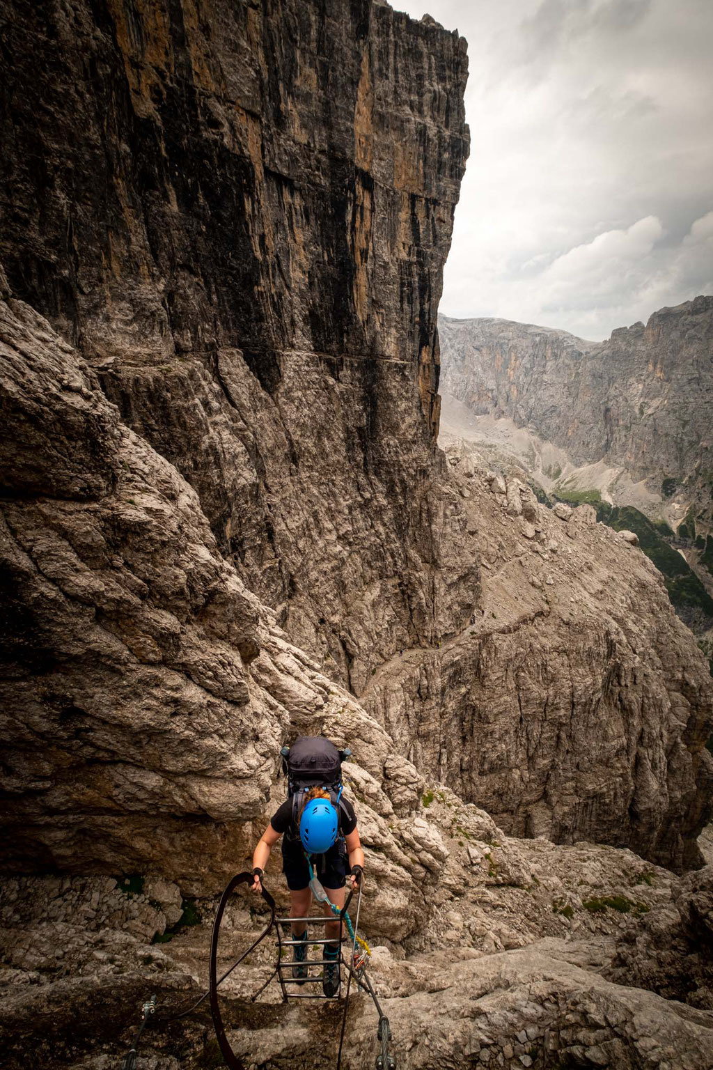 Climbing along the via ferrata SOSAT on the second day of traverse