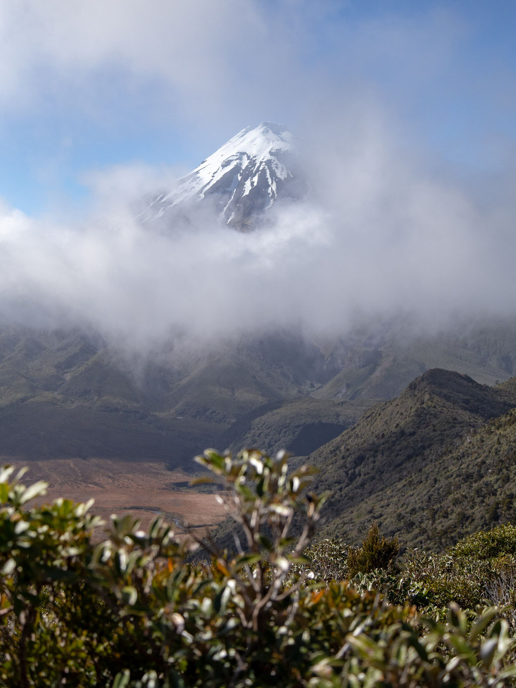 The Taranaki Volcano peaking from behind the clouds
