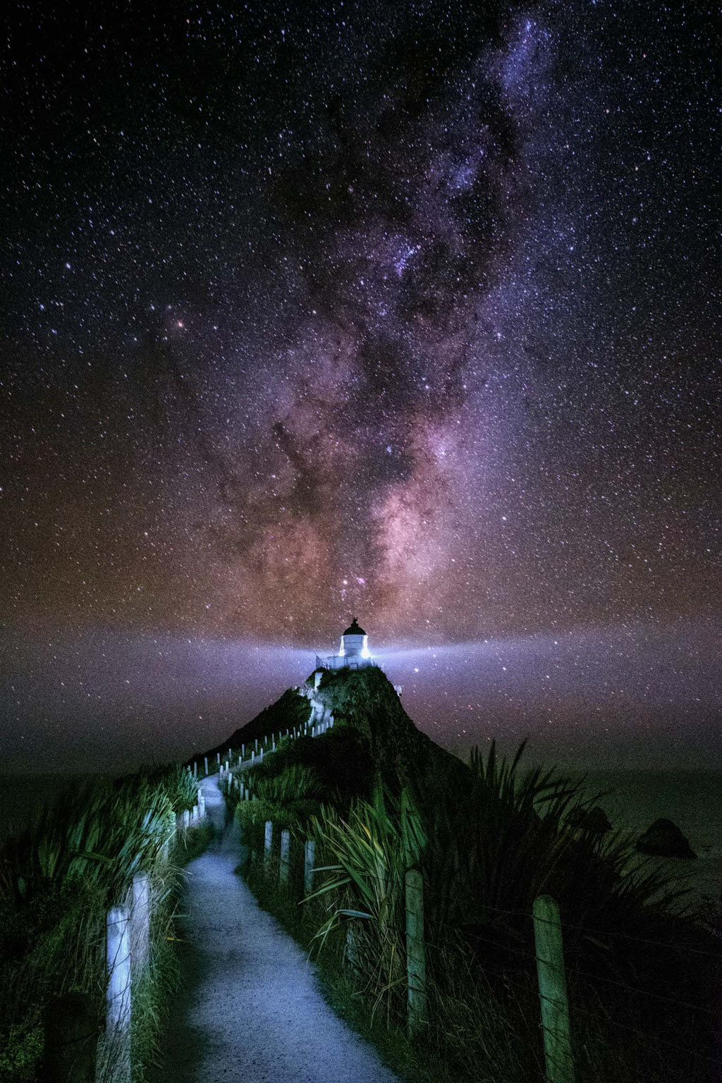Nugget Point Lighthouse with the core of the Milky Way behind it