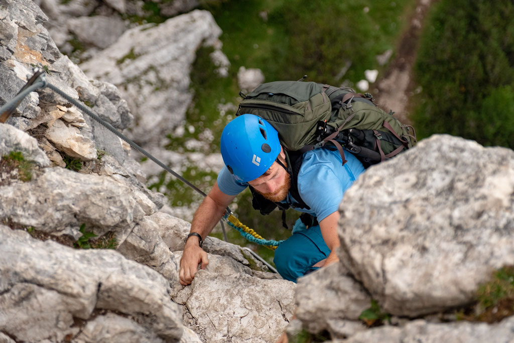 Jack climbing along the via ferrata Ra Bujela