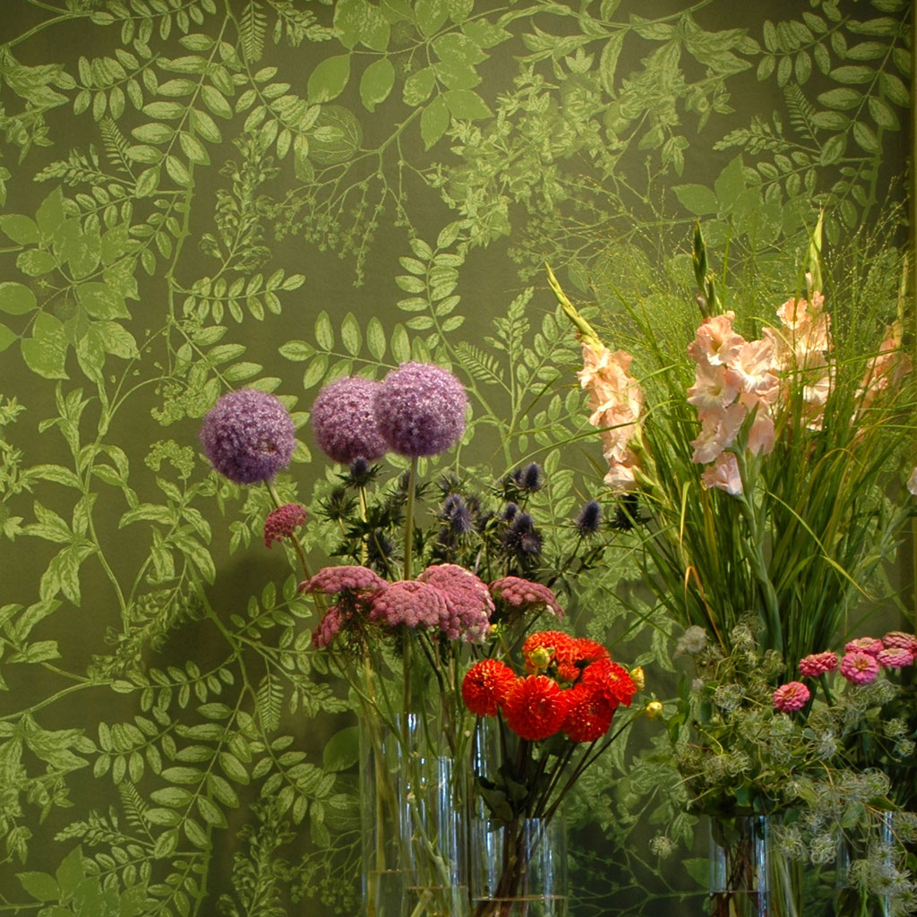 flowers in front of a wallpaper in green shades / custommade patterns