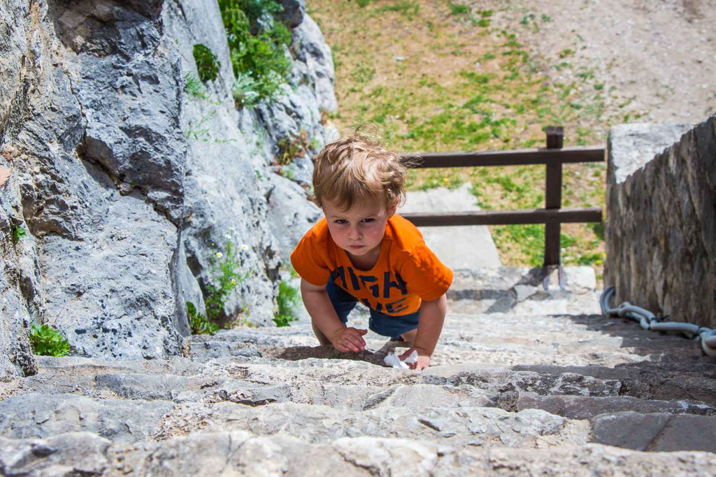 Toddler climbing at Klis Fortress