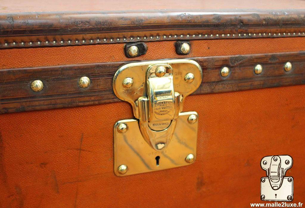 malle cabine Louis Vuitton serrure laiton
