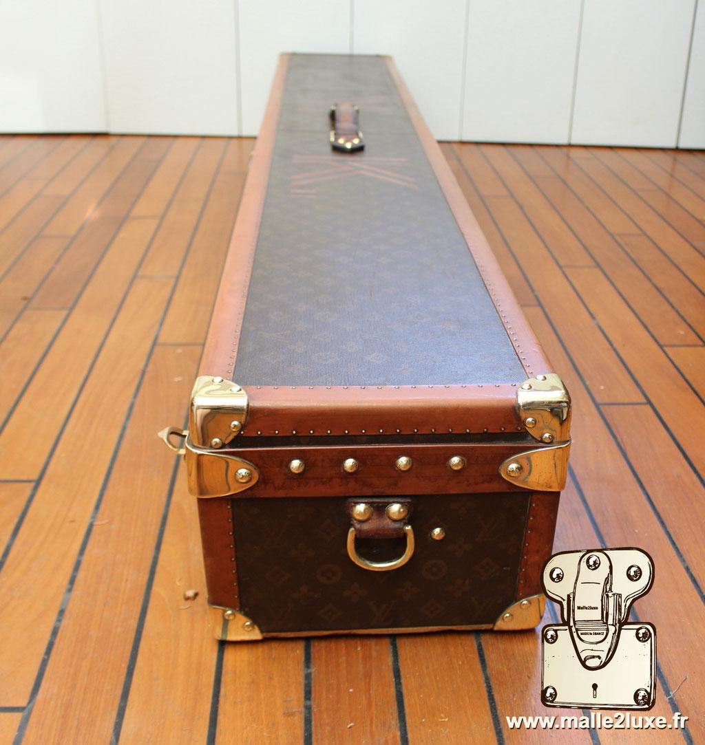 Louis Vuitton trunk side buckle fishing rod