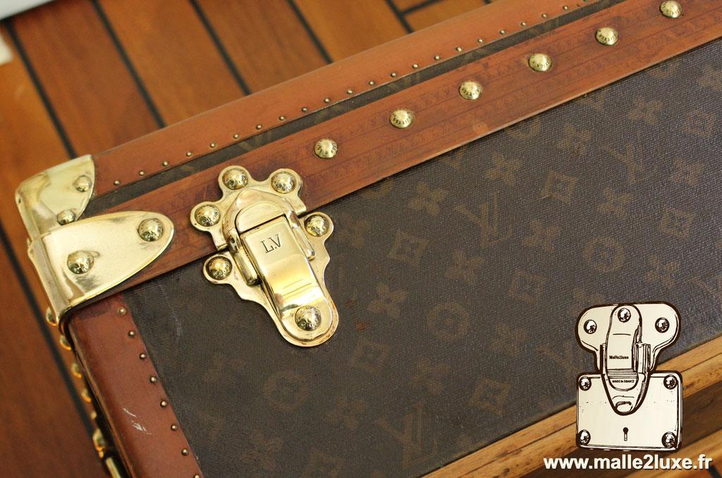 Malle Louis Vuitton canne à pêche fermoirs gauche