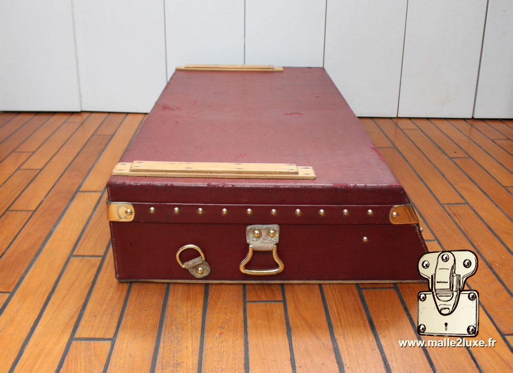Red Louis Vuitton automobile trunk