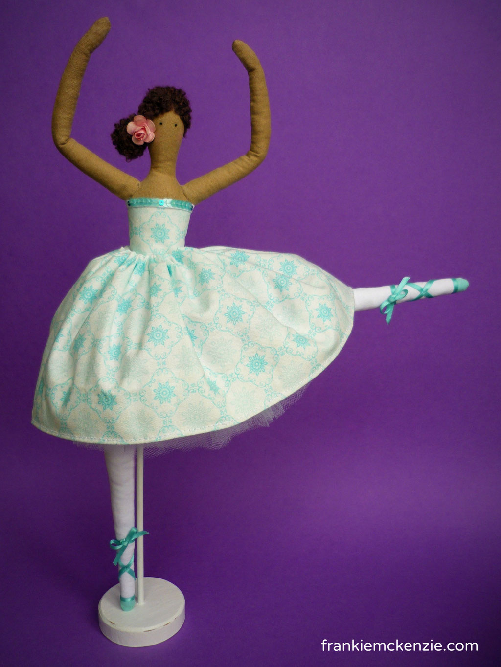 Little Ballerina Tilda doll wearing a white dress with turquoise floral elements