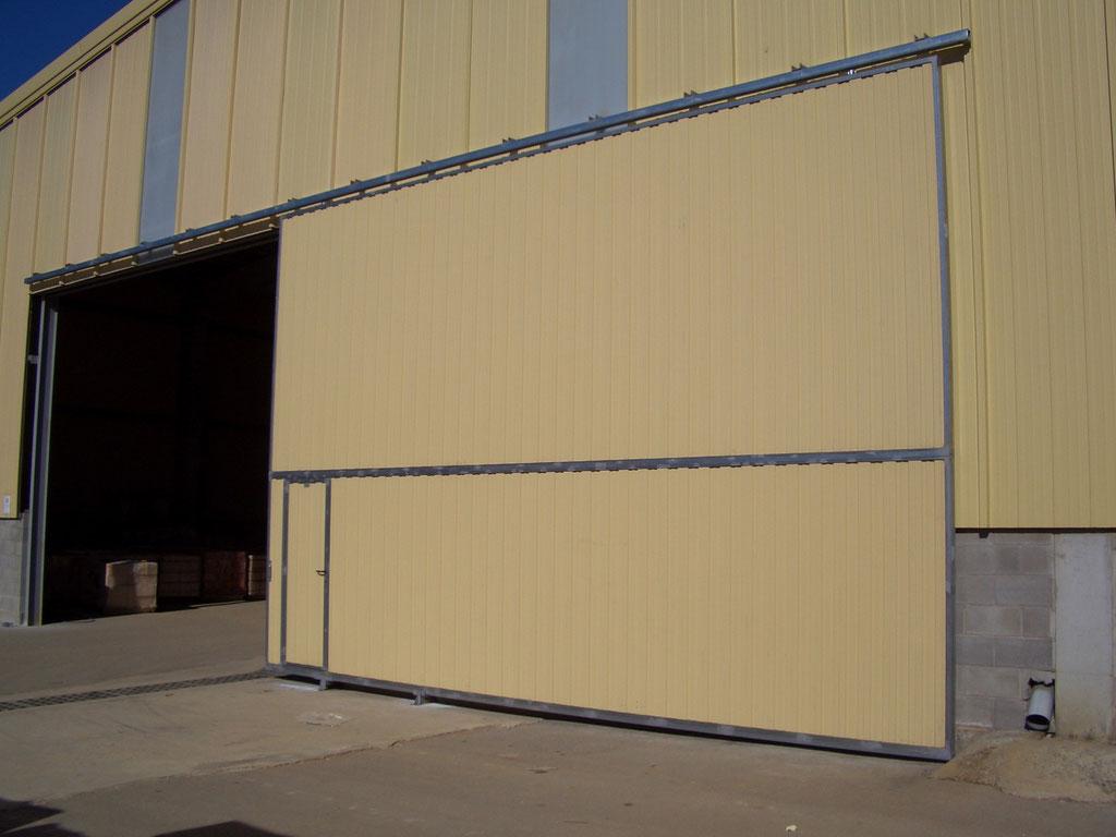 Puertas correderas colgadas rac puertas y automatismos for Puertas correderas colgadas