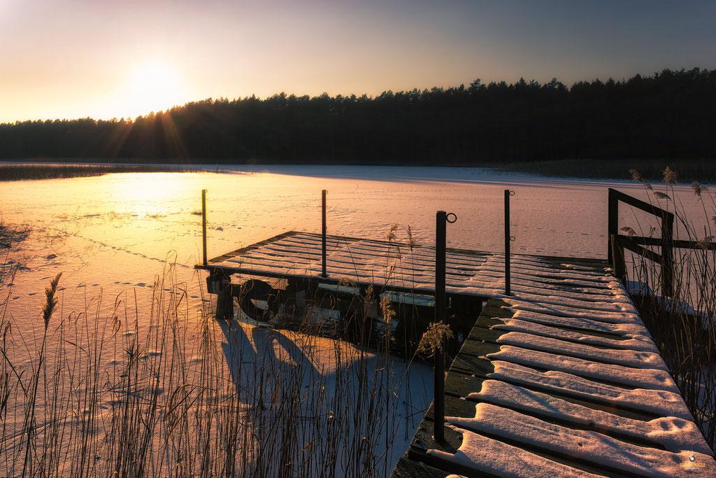 Sonnenuntergang am winterlichen Kastavensee