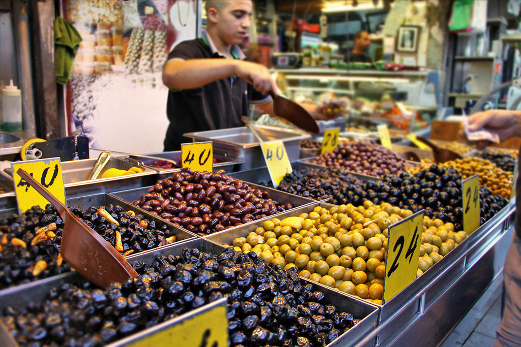 Olives in all sizes and colors... Mahane Yehuda Market in Jerusalem, Israel © Sabrina Iovino | JustOneWayTicket.com