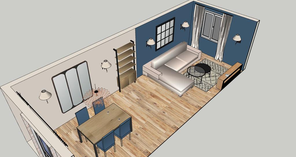 Séjour bleu cosy. Un mur bleu profond, du chêne clair, de la pierre naturelle, un grand canapé beige et quelques touches industrielles.
