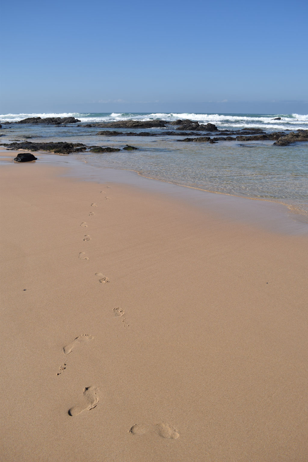 Malhão beach, Portugal - footprints in the sand
