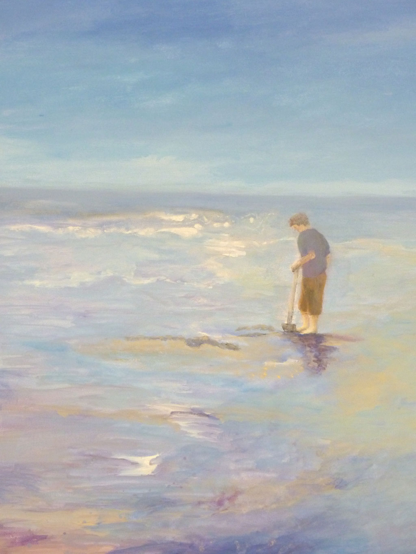 -.- Junger Mann mit Spaten am Meer