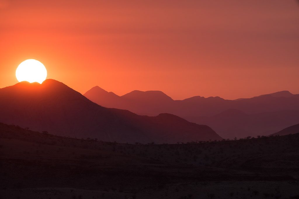 Setting sun near Warmquelle, Namibia