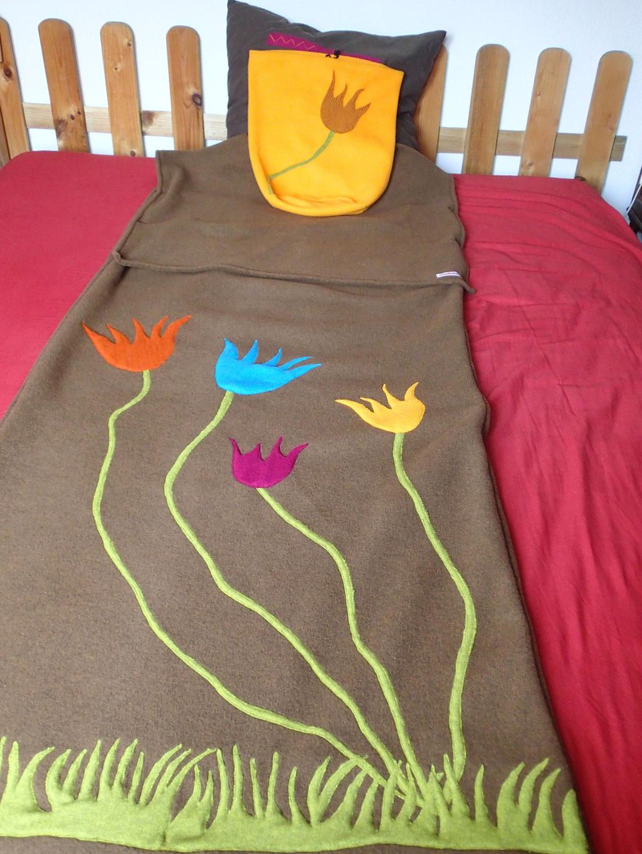 """Sac de couchage """"Dans le jardin"""" et son sac de rangement"""