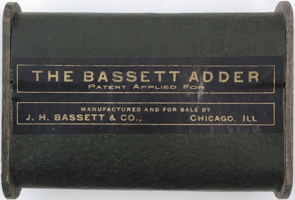 Reverso THE BASSETT Adder Nº 1, patent applied for, fabricado por J. H. Bassett & Co., Chicago, Illinois (USA)