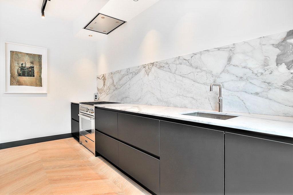 Calacatta marble kitchen in book match