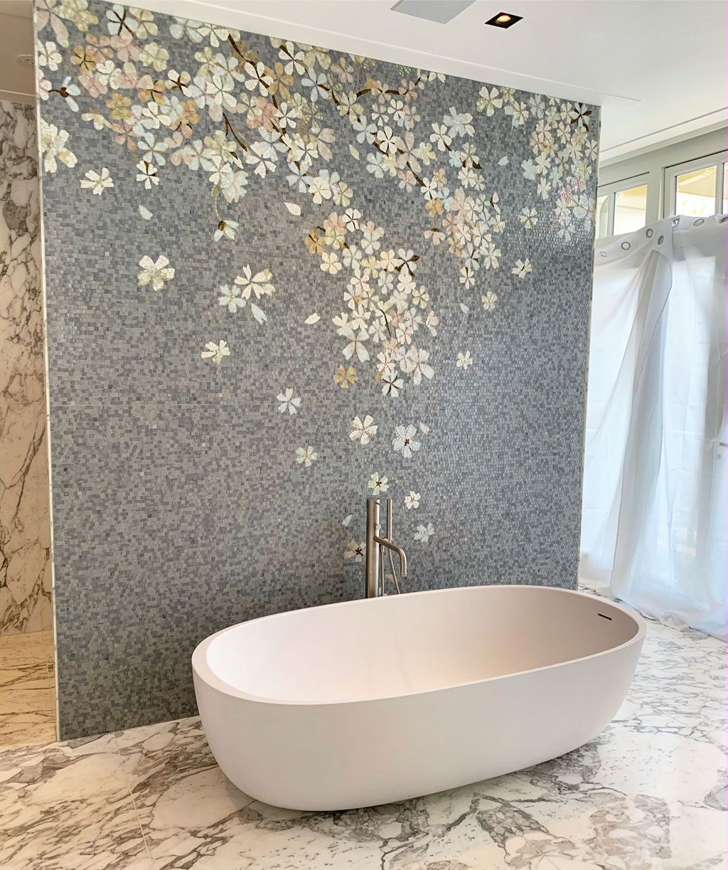 Calacatta marble with glass mosaic bathroom