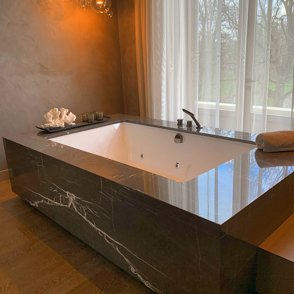 Pietra Grey marble bath in book match