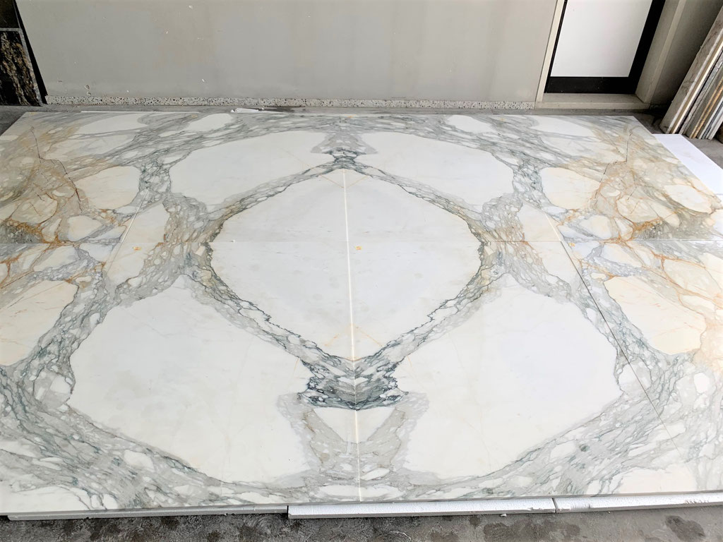 Making the perfect book match with natural marble