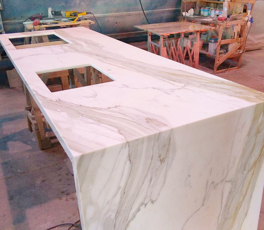 Final quality check of marble kitchen in production
