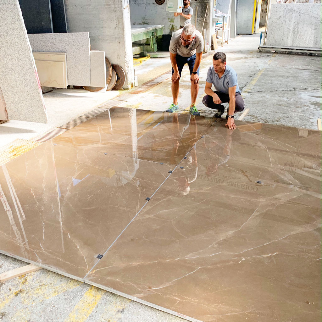 Laying out the diamond match in Bronze Armani marble