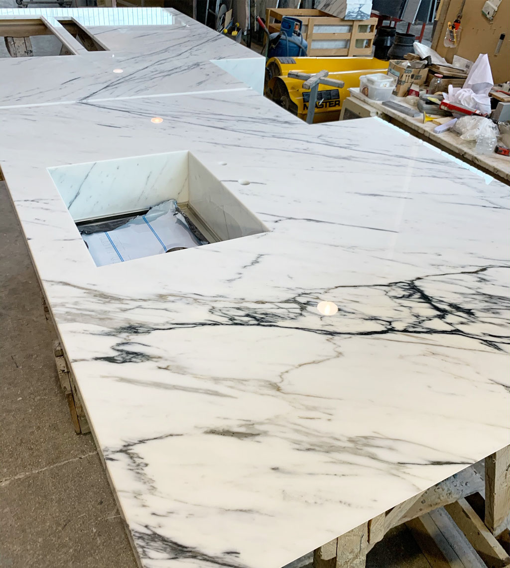 High-end kitchen in Statuario marble