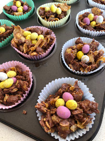 Adding the mini eggs to complete the easter nests
