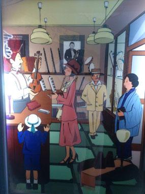 今井楽器店のイラスト(道頓堀浮世小路)「貴志康一ヴァイオリンリサイタル」のポスターが描かれている。