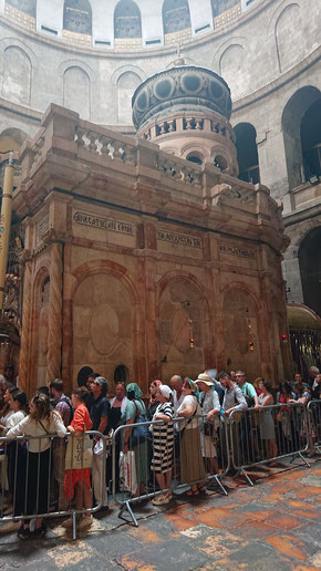 The long line to visit the Sepulchre of Christ inside a chapel called Edicule.