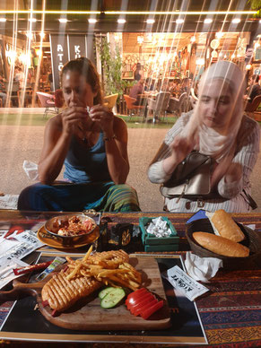 Viviane and Suada at a local restaurant