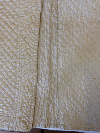 C18th quilted bedgown, showing centre back lining seam. BATMC 97.18 (loan)