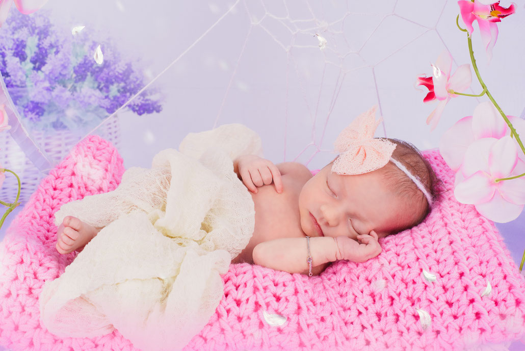 newborn on a pink fabric