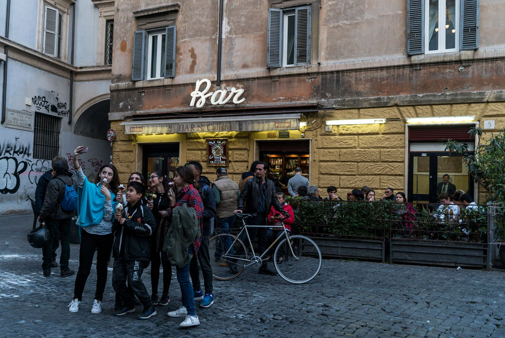 "Trastevere after sunset in 2017: The ""selfie generation"" doing its thing. I really like the old facade of the bar."