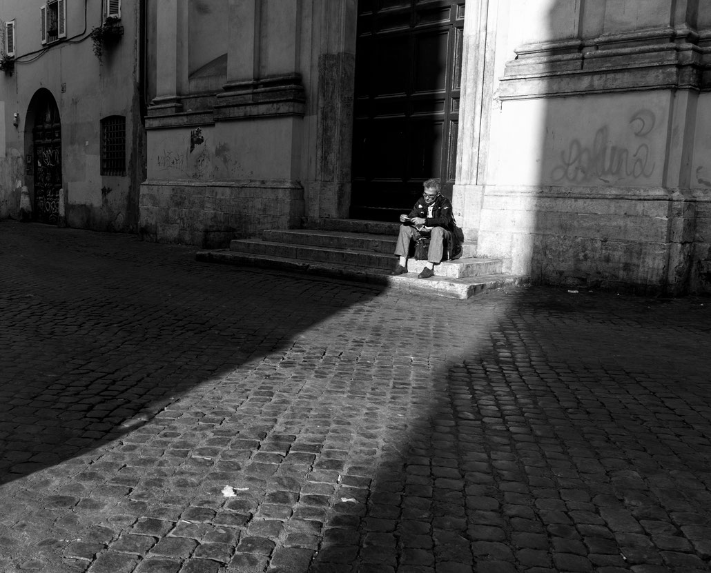 A classic street scene: Strong lights and shadows in Trastevere during the late afternoon