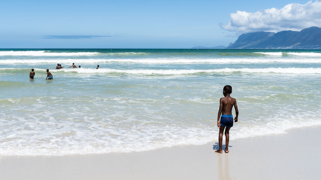 Children playing at the shore of the False Bay in Muizenberg