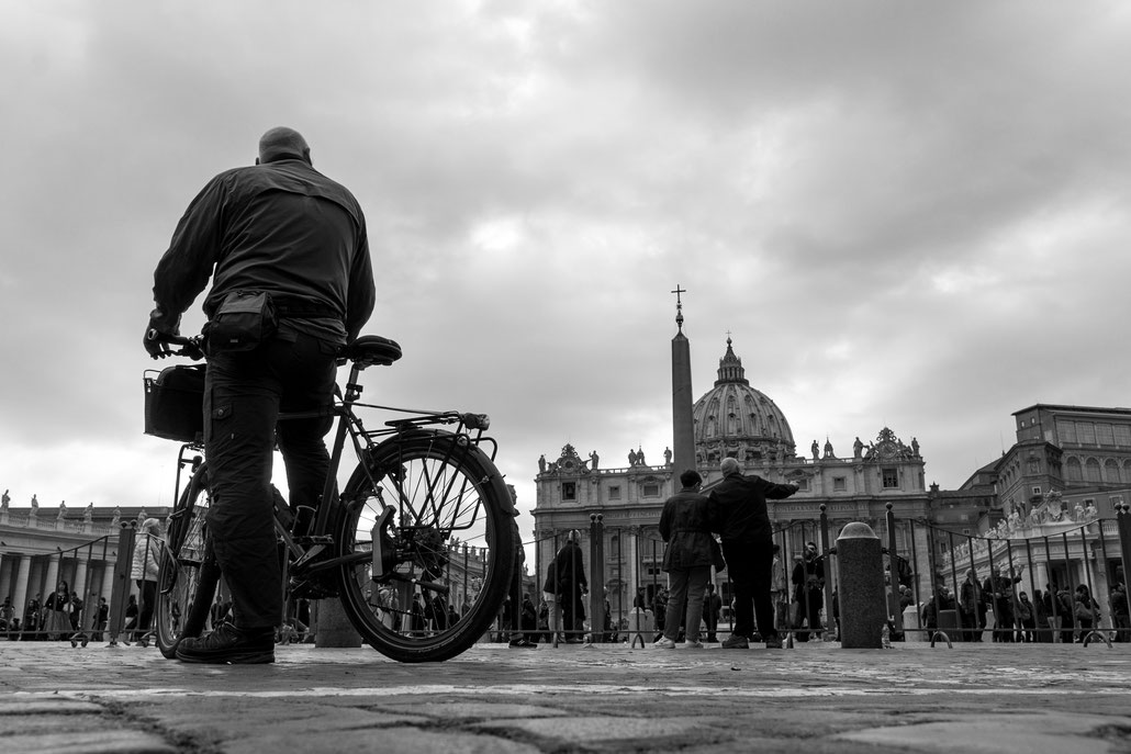 One of my favorite Rome street shots: A cyclist in awe about the beauty of St. Peter's Square and its basilica