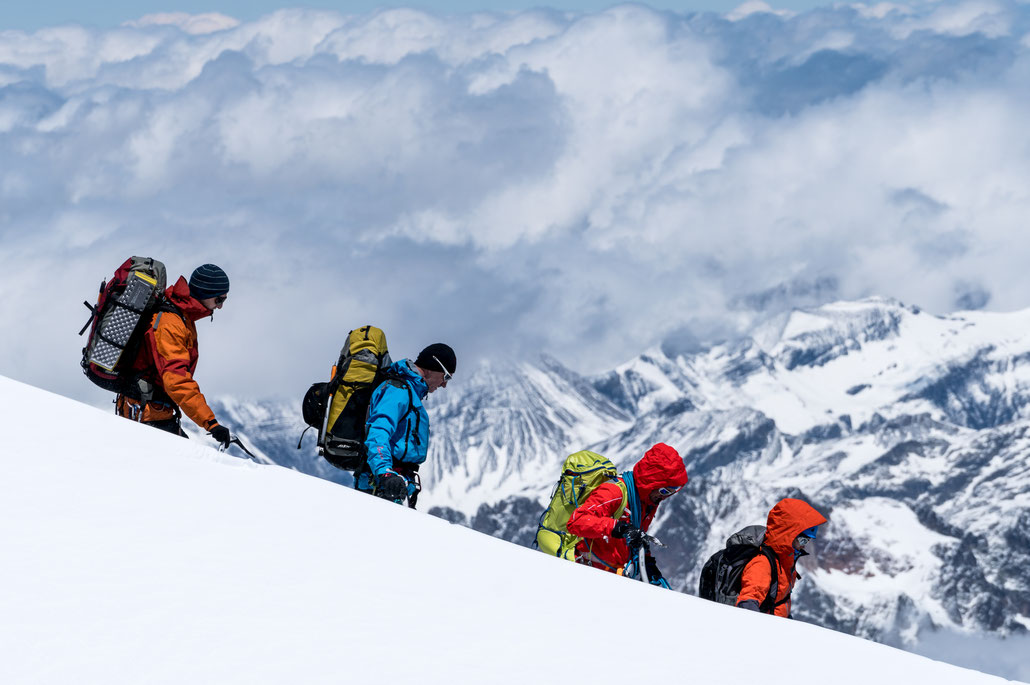 You can walk around board walks on Aiguille du Midi and this really looks as if I am in the scene: A group of hikers starting their descend towards the ice field around Mont Blanc.