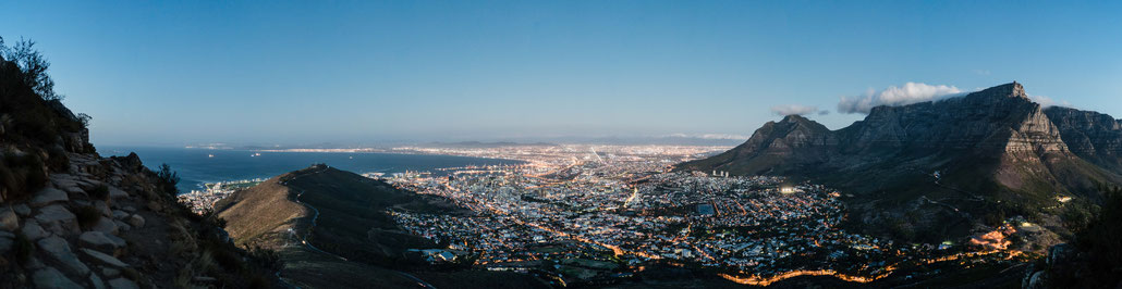 Table Mountain, Capetown city bowl and Signal Hill seen from Lion's Head during dusk